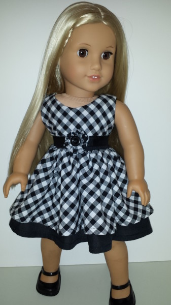 American Girl Doll wearing gingham dress